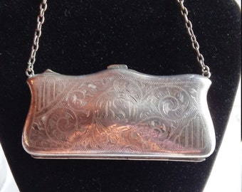 Vintage 1920s Art Deco/Art Nouveau Coin Pouch/Metal Purse. The Manufacturer is E.P.N.S.  Very nice condition inside and out. Solid Metal.