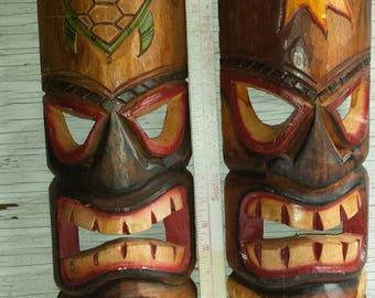 2 Beautifully Carved Spirituality-Masks of the Native Americans.  One has the sun, symbol of happiness. The other a turtle or mother earth.