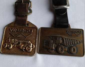 2 Wabco-Westinghouse Air Brake Company Advertising Watch FOBs. Both Depict Heavy Earth Moving Equipment.