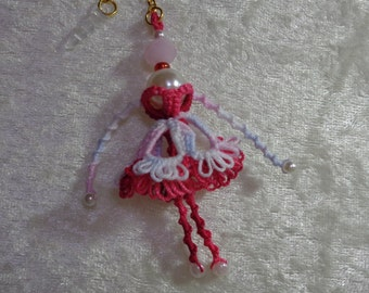 Small dolls lace frills and pearls