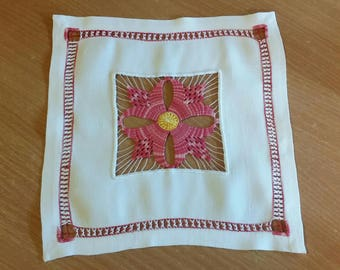 Red embroidered doily cilaos days
