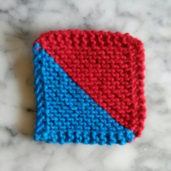Knitted coasters: diagonal graphic red & blue wool coasters. Chunky wool. Made in Ireland. Matching place mats available. Home gift.