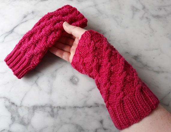 Cable knit armwarmers: handknit in pink merino wool. Knit wristwarmers. Original design. Made in Ireland. Aran knit gloves. Matching hat.