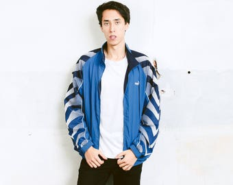 Puma Shell Jacket . Vintage Blue 90s Jacket Windbreaker 90s Sports Jacket Activewear Spring Jacket Outerwear 90s Men Clothing . size Large L
