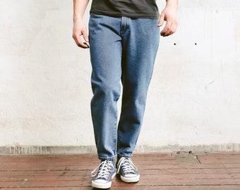 Vintage Men Tapered Jeans . Medium Wash Jeans Blue Denim Pants Classic Boyfriend Jeans 1990s Clothing Five Pocket Jeans . size Medium / 44