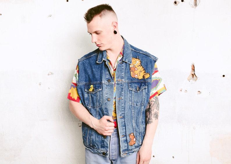 5ddfe7166 Garfield Patch Denim Vest . 90s Medium Wash Sleeveless Denim Jacket Patched  Vest Oversized Jean Vest Hipster Punk Vest . size Large L