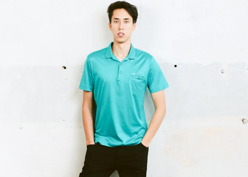 d8a2848925f4 Fila Polo Shirt . Vintage Activewear Mens Blue T-Shirt Golf | Etsy