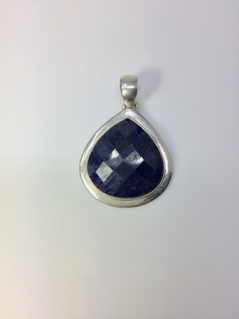 Sterling silver pendant with blue stone