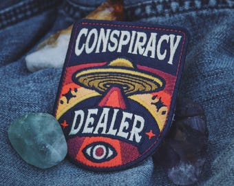 """Conspiracy Dealer Patch - Metaphysical Fashion Accessory - 3"""" Iron On Embroidered Patch - Aliens, UFO, Conspiracies, Esoteric, Truther Badge"""