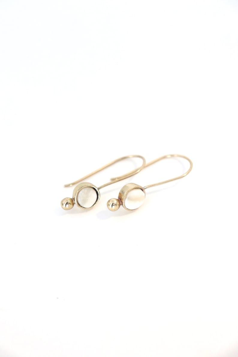 Made in Haiti Gold Horn and Bone Dangle Earrings Handmade, dainty, trendy, beautiful jewelry, artisan made Okap Earrings