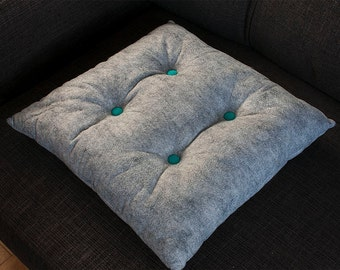 Grey felt dot cushion with turquoise buttons