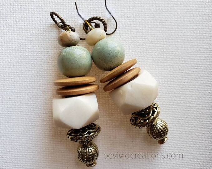 READY TO SHIP beautiful beaded earrings using bone, ceramic, wood, brass and a rondel semi precious stone.