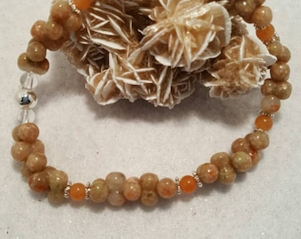 """Autumn Jasper and Red Aventurine beads with silverplated spacers 8""""  stretch bracelet."""