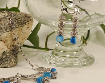 Necklace and her earrings, silver and Pearly beads blue.  boho style.