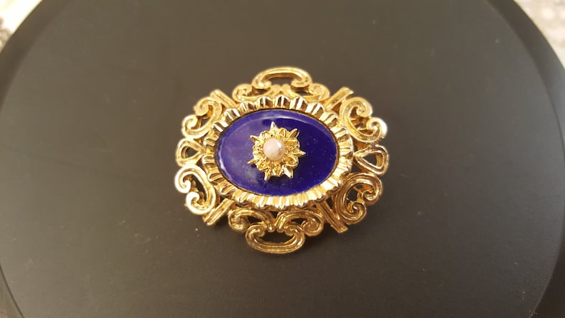 a11c9581fe4b5 Gold Ornamental Brooch with Mini Pearl over Gold Starburst and Blue Stone