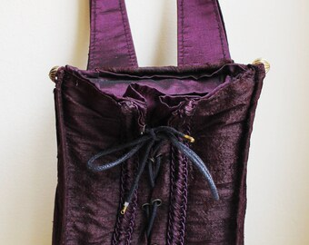 Authentic vintage crimson corset bag