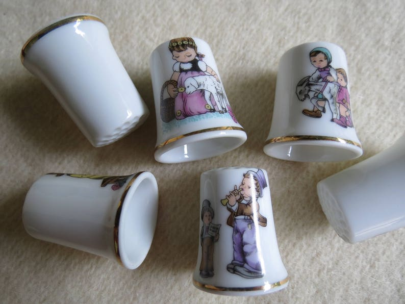 Charming Norman Rockwell Children Sewing Thimble Set of 6 Porcelain Thimbles