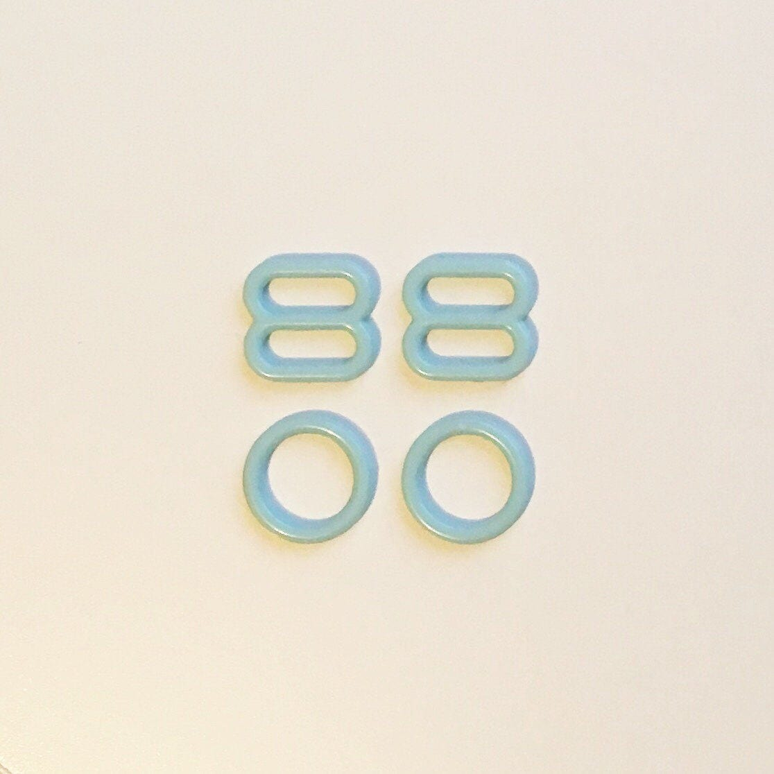 4f61e1d6bce79 1 Set of Blue Rings and Sliders    8mm    Coated Metal    Bra Making  Supplies