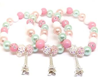 Pastel Eiffel Tower bracelets party favors in organza bags - Girls Eiffel Tower birthday supplies