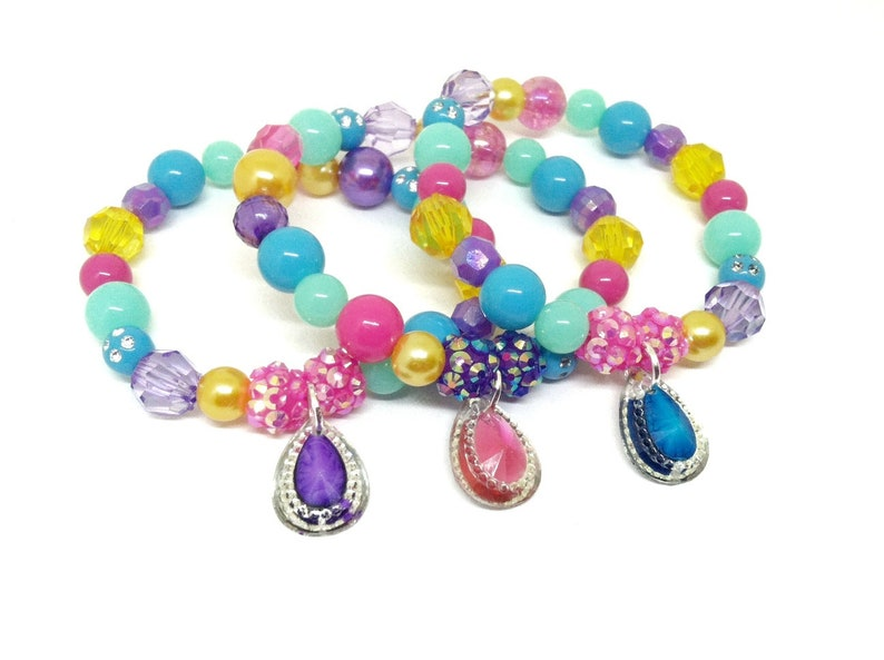 Genie gem party favors bracelets in organza bags - Genie birthday supplies