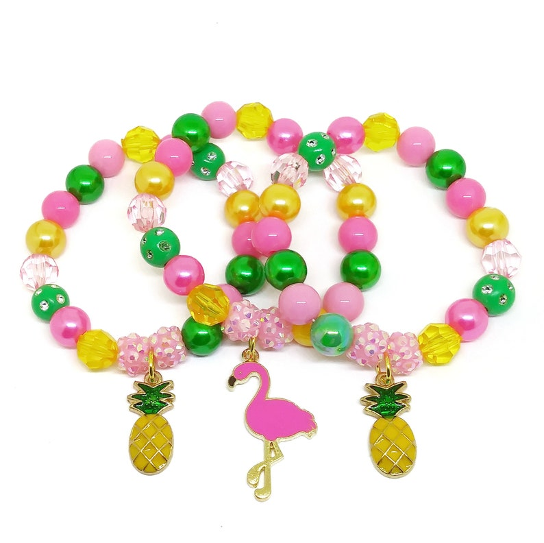 Pineapple and flamingo bracelets party favors in organza bags image 0