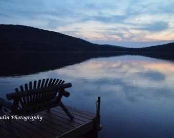 Sunset over Lake with a bench and dock photo - Calm, Peaceful spot to sit with sky reflection in lake - Wall Decor