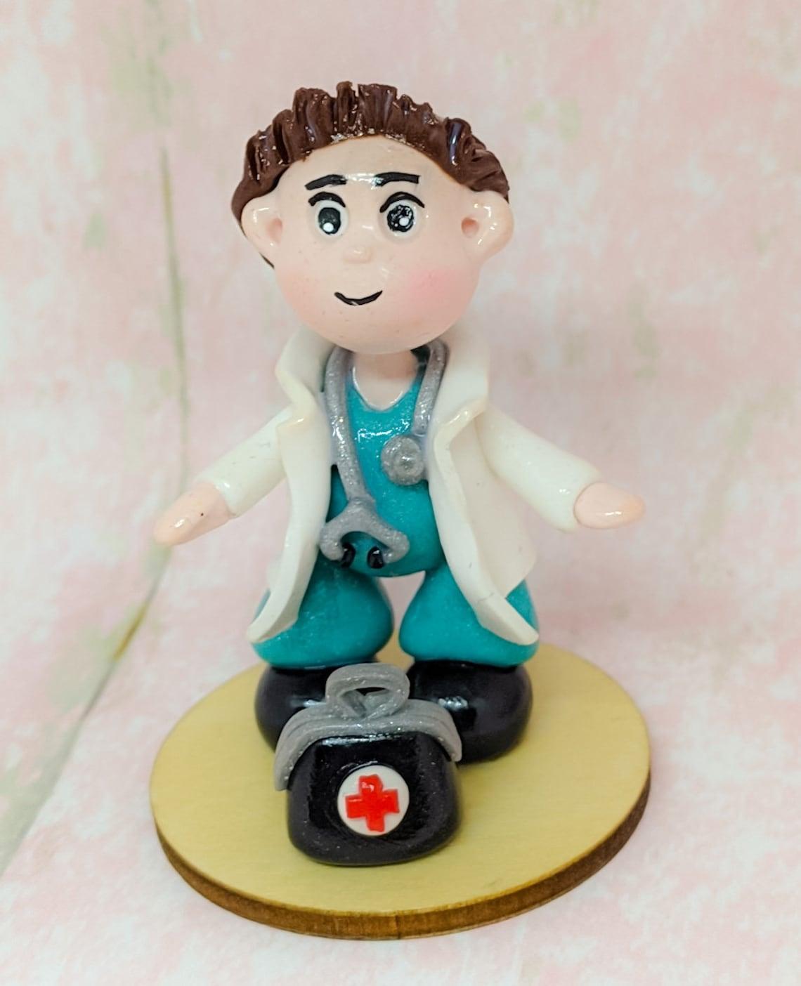 a clay doctor figurine.