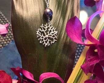 Peacock Pearl on Silver Coral