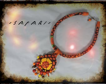 SOLD - SAFARI necklage - crewneck fabric multicolored predominantly Brown and orange - orange leather - wood beads and metal