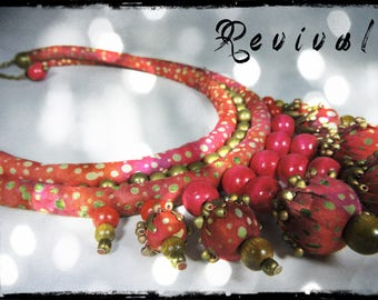 REVIVAL - fabric necklace with dominant red, purple, rust, fuchshia and Garnet - light khaki and light green patterns - beads