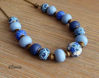 Beaded necklace textured floral pattern in shades of blue, polymer clay