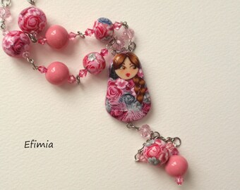 Nesting Doll (matryoshka) necklace with pink and gray polymer clay flowers