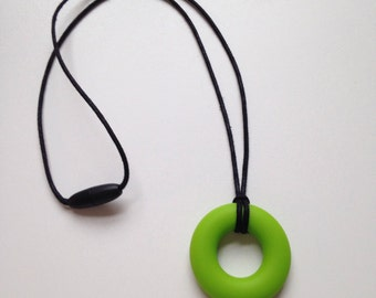 Retro kitsch teething pendant necklace - Chartreuse green BPA free silicone chewable teething ring by Little Gnashers