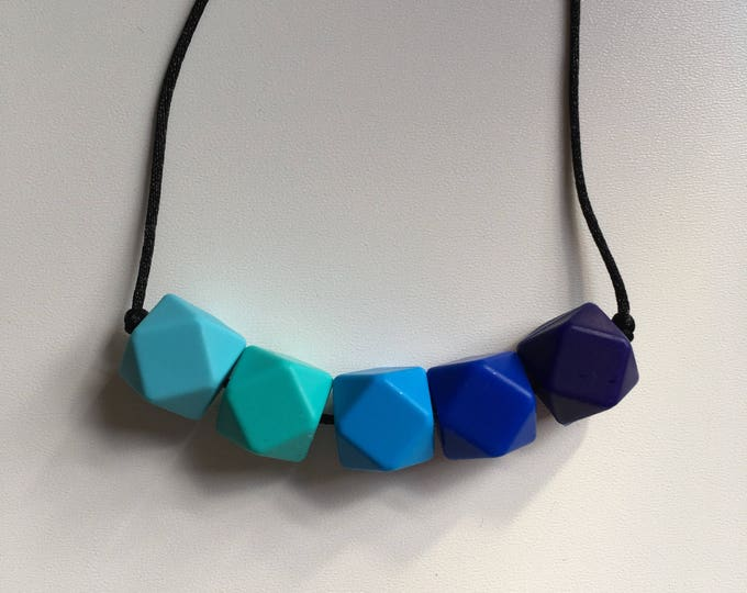 Teething necklace in azure, turquoise, sky blue, ultramarine, navy; made from BPA free chewable silicone hexagon beads by Little Gnashers