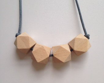 Wooden teething necklace featuring organic untreated Canadian maple hardwood hexagon beads by Little Gnashers