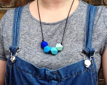 Teething necklace made from BPA free chewable silicone hexagon beads by Little Gnashers