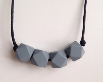 Teething necklace in grey made from BPA free chewable silicone hexagon beads by Little Gnashers