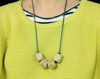 Wooden teething necklaces featuring organic untreated Canadian maple hardwood by Little Gnashers