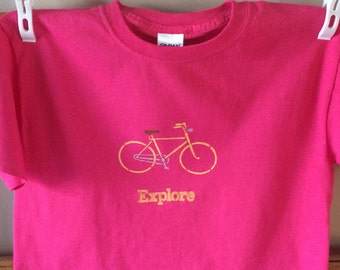 Bicycle t-shirt youth lg deep pink with bicycle and Explore stenciled on it