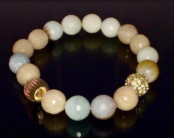 10mm faceted Amazonite beads with one 10mm Gold plated Cande Pave Crystal bead and more... bracelet