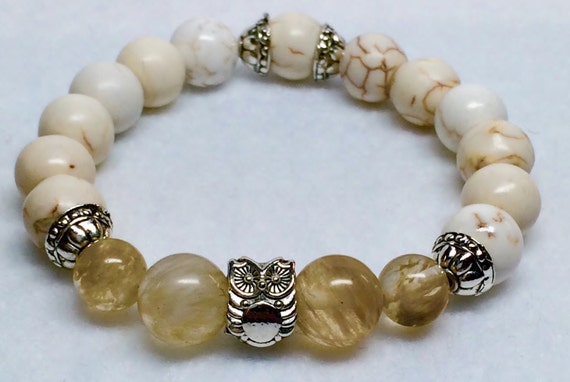 10mm Natural Beige Turquoise beads, four 10mm rutilated Quartz beads, one 12mm Pewter Bali Owl bead Bracelet