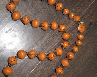 Vintage 1950s brown black beaded hand painted string necklace