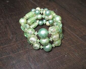 Vintage 1950s green beaded wrap cuff bracelet