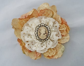 Brooch, old charm Brown cameo with lace and feather
