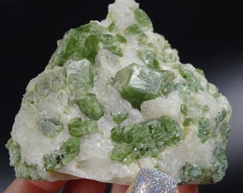 Numerous Diopside Crystals on Snowy White Albite