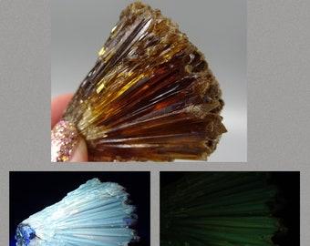 Fluorescent and Phosphorescent Amber Calcite Cluster