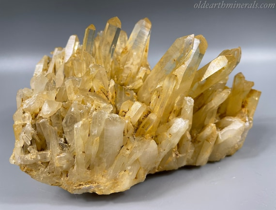 Clear Quartz Crystal Cluster With Natural Golden Yellow Iron Oxide Coated Surface