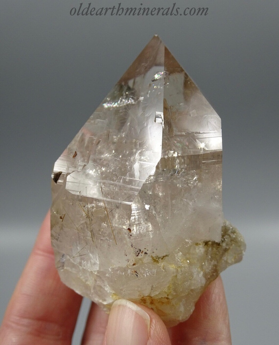 Slightly Smoky Clear Quartz Crystal with Golden Rutile