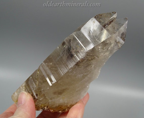 Large Slightly Smoky Twin Quartz Partial Crystal with Red Mica and Rainbow Inclusions