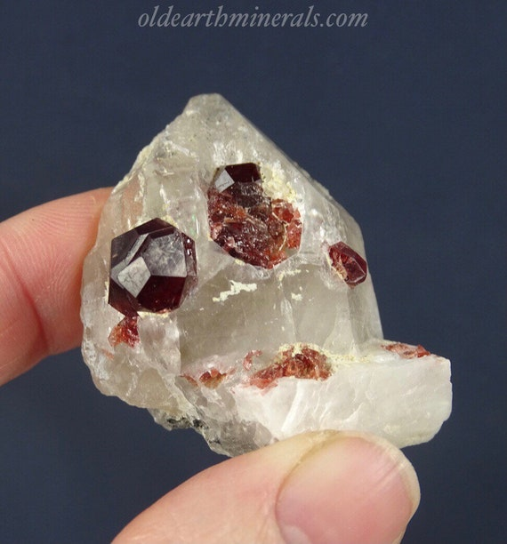 Red Garnets on Quartz Crystal with Minor Calcite and Black Tourmaline